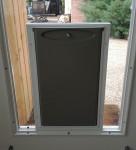 Lewisville Pet door in glass door installation_LD Glass Co_h600